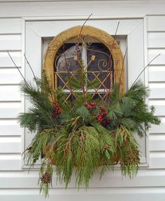 Prim Window Box...with old wood & wrought iron trim...stuffed with pine & berries.