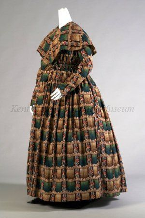 "1840-1849 Maternity dress and pelerine; cotton printed in dark green, brown, tan, blue and red plaid. Dress, high neck, open front, drawstring high waist, slim sleeves, full skirt. Self pelerine.  ""During pregnancy, women could wear less structured garments for leisure at home. However, boning and corsetry were expected outside the home. This dress, gathered with drawstrings in both bodice and skirt, accommodated the changing body.""  Via Kent State University Museum."
