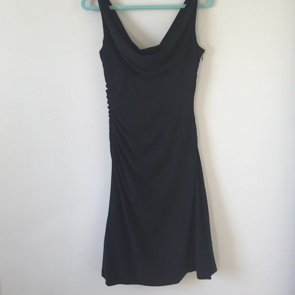 Little black dress WHBM Scoop neck black fitted WHBM dress. Side zip on left and button detail down right side. VERY flattering dress White House Black Market Dresses