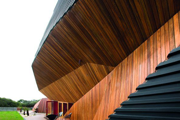 The use of spotted gum cladding and decking reflects the - Wooden cladding for exterior walls ...