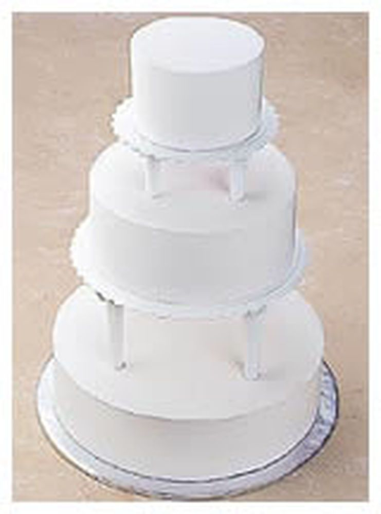Push In Tiered Cake Construction Tiered Cakes Cake Pillars Cake Icing Techniques