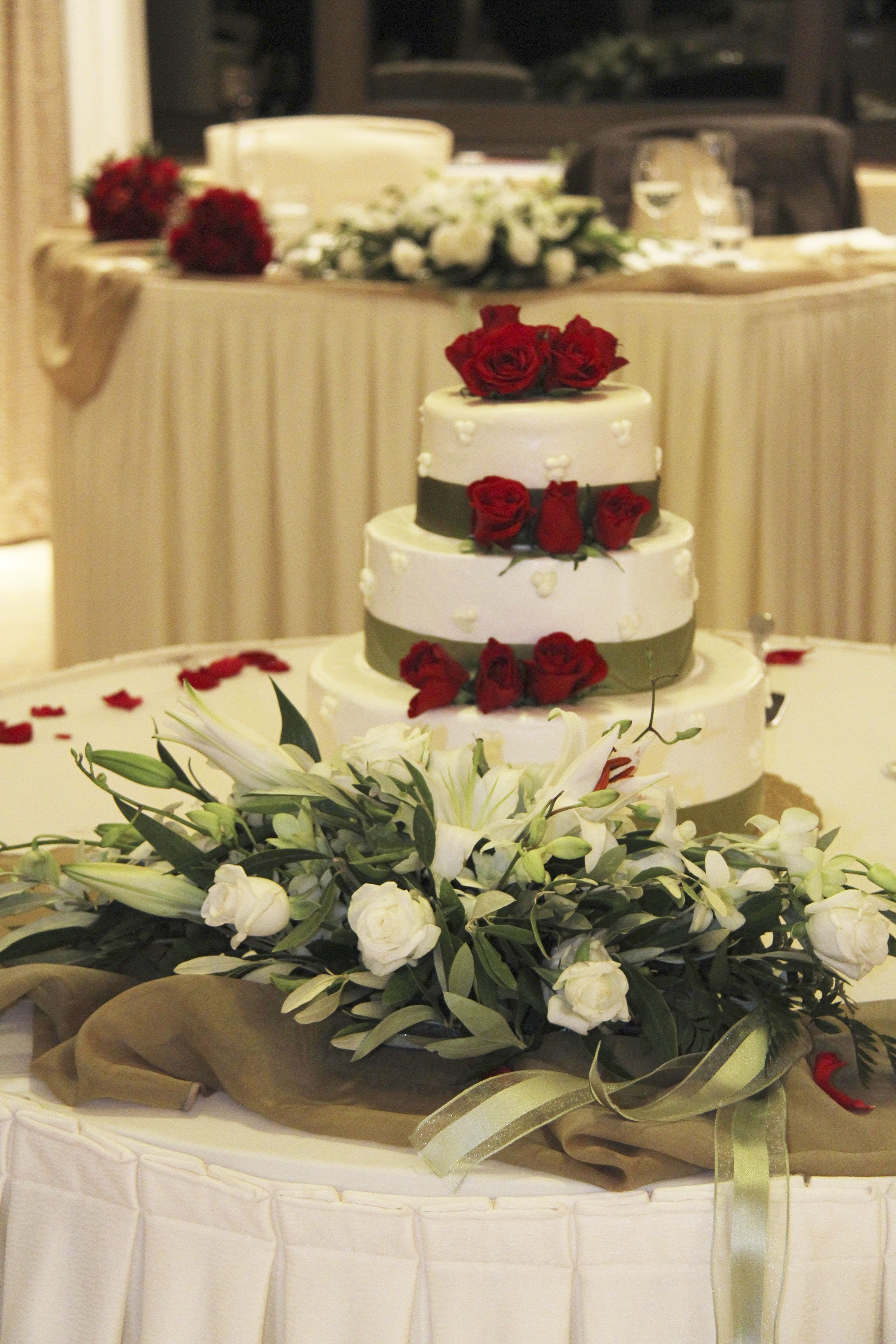 our cake was decorated with beautiful, simple real red roses to ...