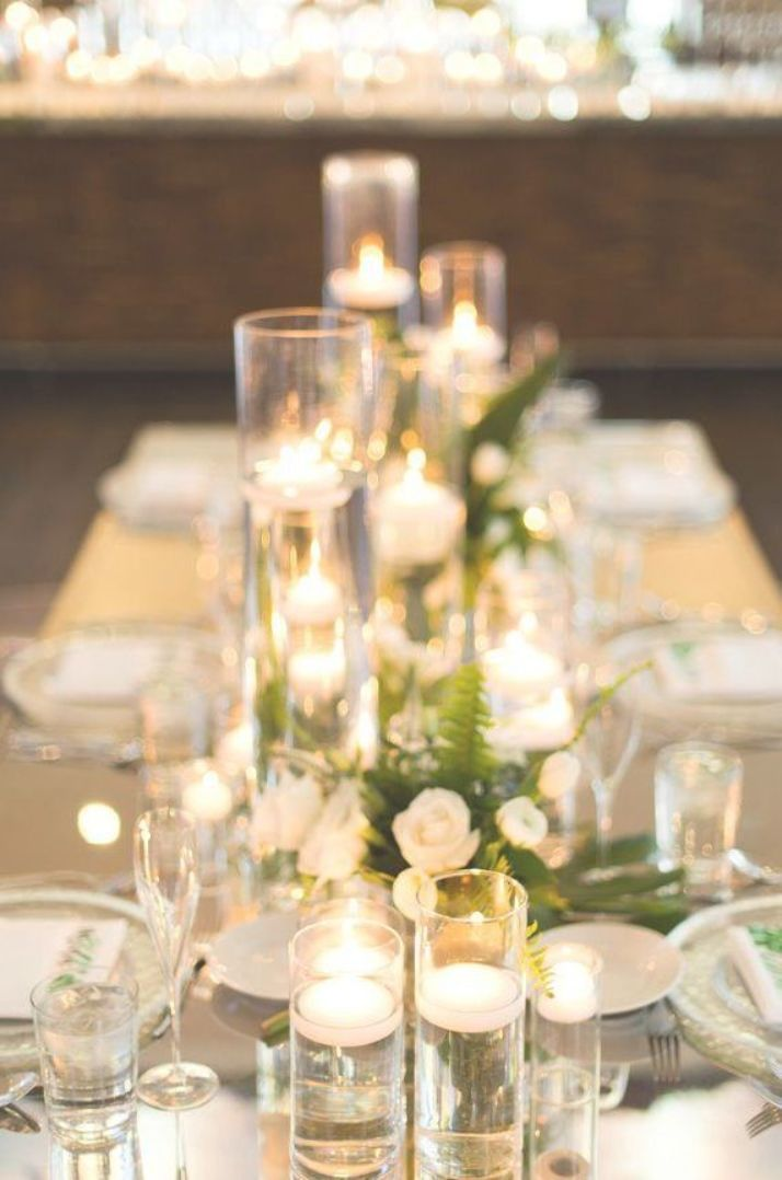 Long wedding mirror tablescape centerpiece with white flowers and greenery | elegant wedding table with candles - Studio EMP  #table #tablesetting #tablescape #tabledecor #centerpieceideas #weddingdecor #weddingdecorations #whitecandleswedding