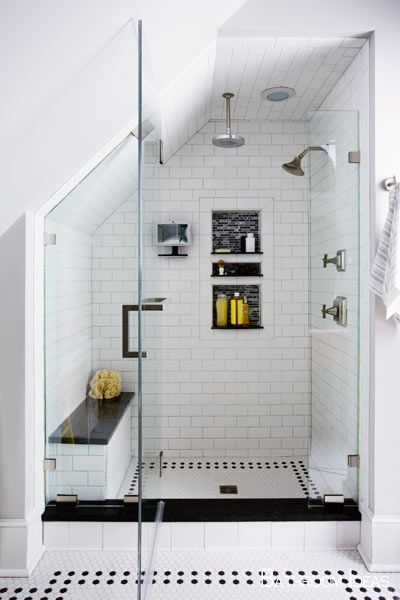 Ash Gray Tile And A Roman Wall Bound An Expansive Shower