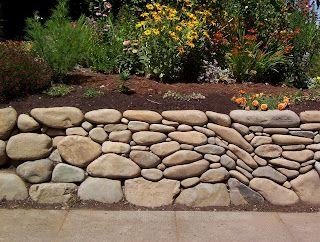 River Rock Retaining Wall Fluid Art Love It Landscaping With Rocks River Rock Landscaping River Rock Garden