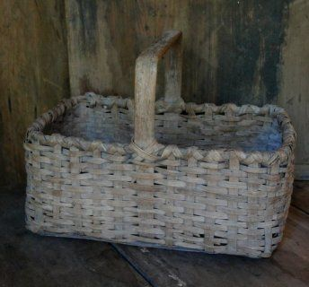 Early splint basket in patina with thick wood handle.