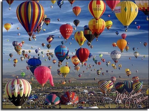 If you have never been to a hot air balloon race, go to one.  They are spectacular on an early fall day!