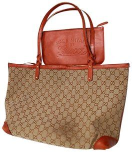 2afbd3803fcd Gucci Satchel Tote Excellent Condition High-end Bohemian W  Pouch Wallet  Tote in brown large G logo print canvas and metallic orange copper leather