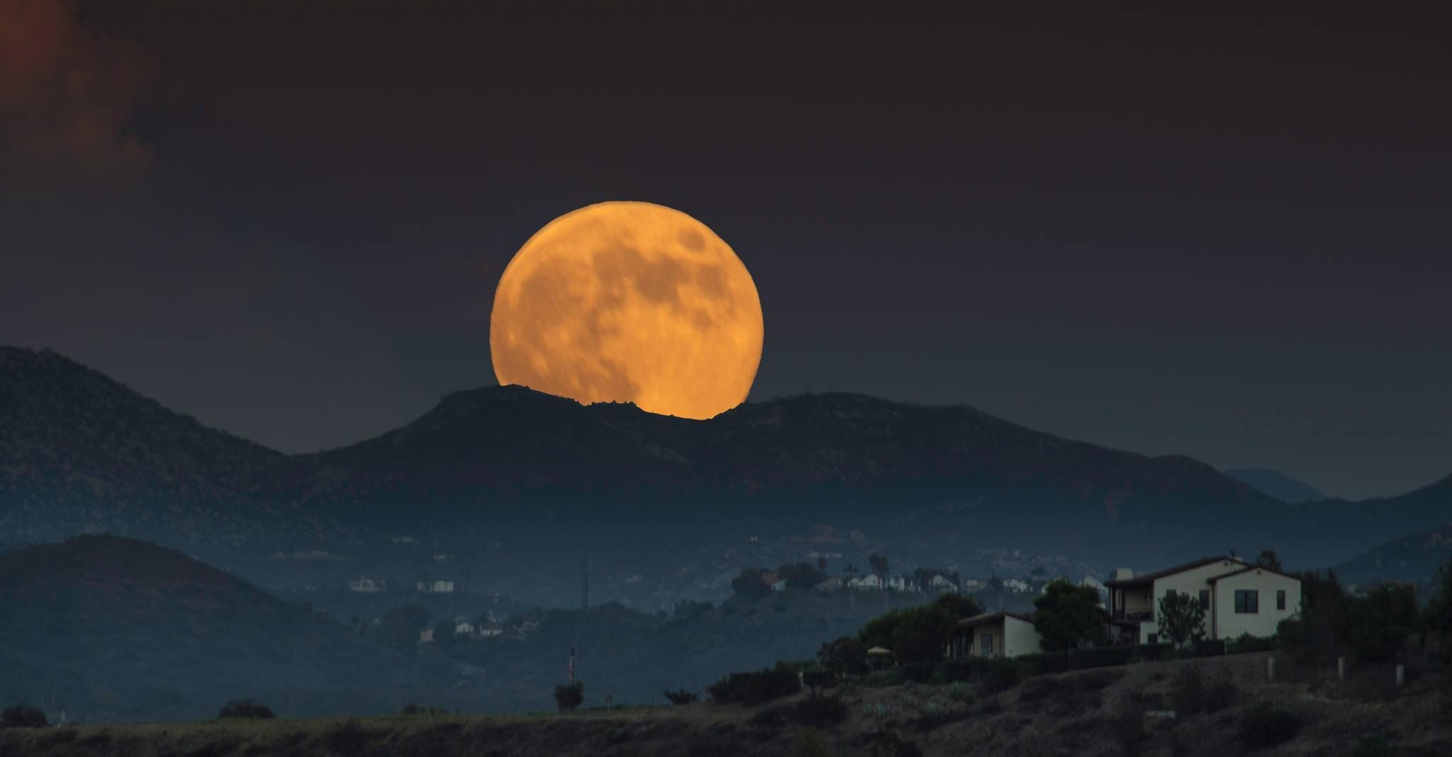 rise of supermoon over San Diego  Photo by Michael Maris.