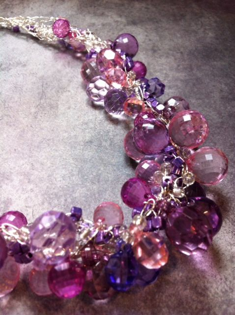 Lilac Lace...these colors remind me of my neighbor's lovely hydrangeas.  Wire crochet accented with resin beads in shades of lilac, pink, and purple.  Susan Bowerman, Woodside WireWorks