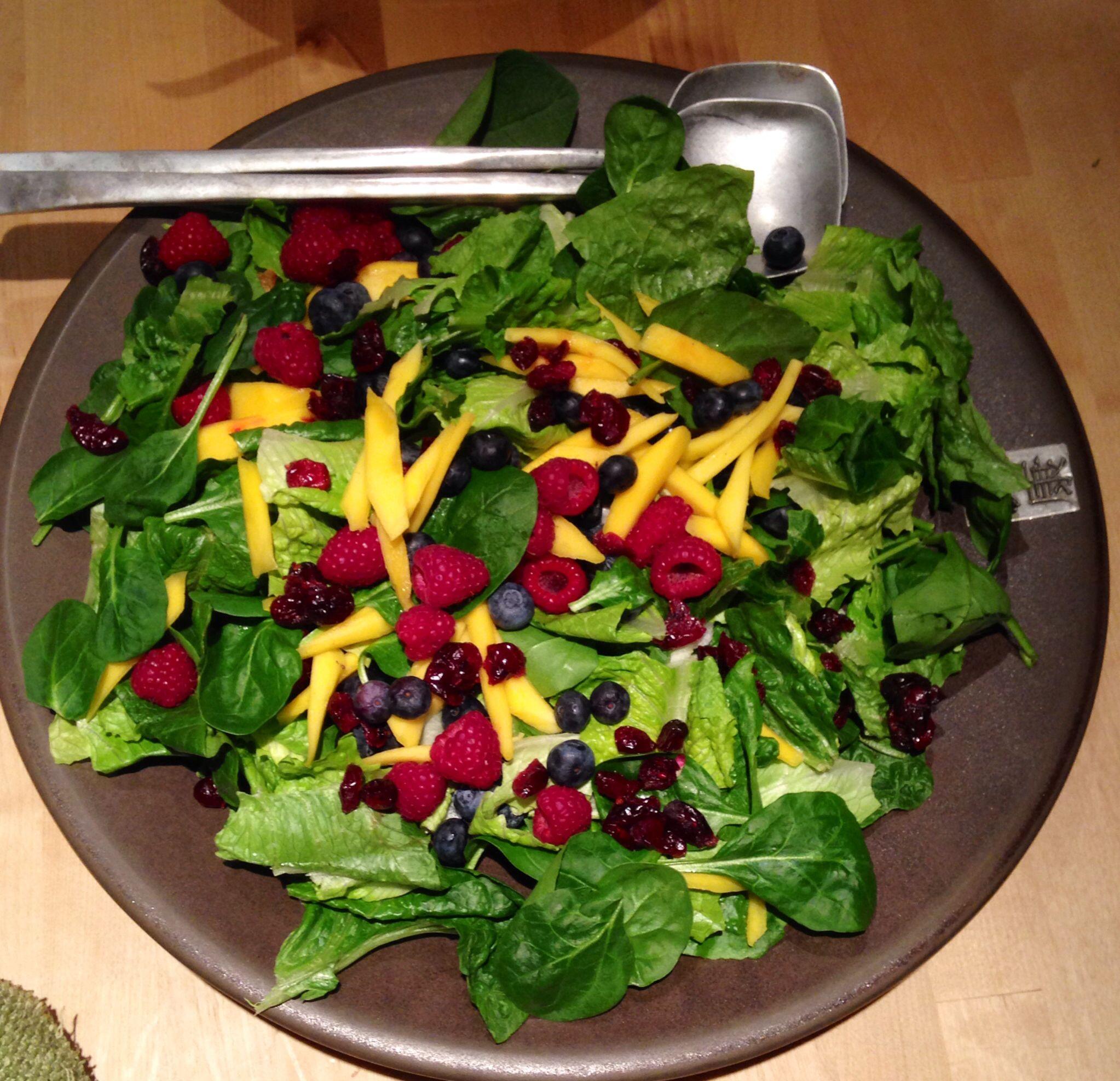 healthy salad -spinach, mango, lettuce, raspberries, dried cranberries, blueberries, vinaigrette dressing  -delicious!