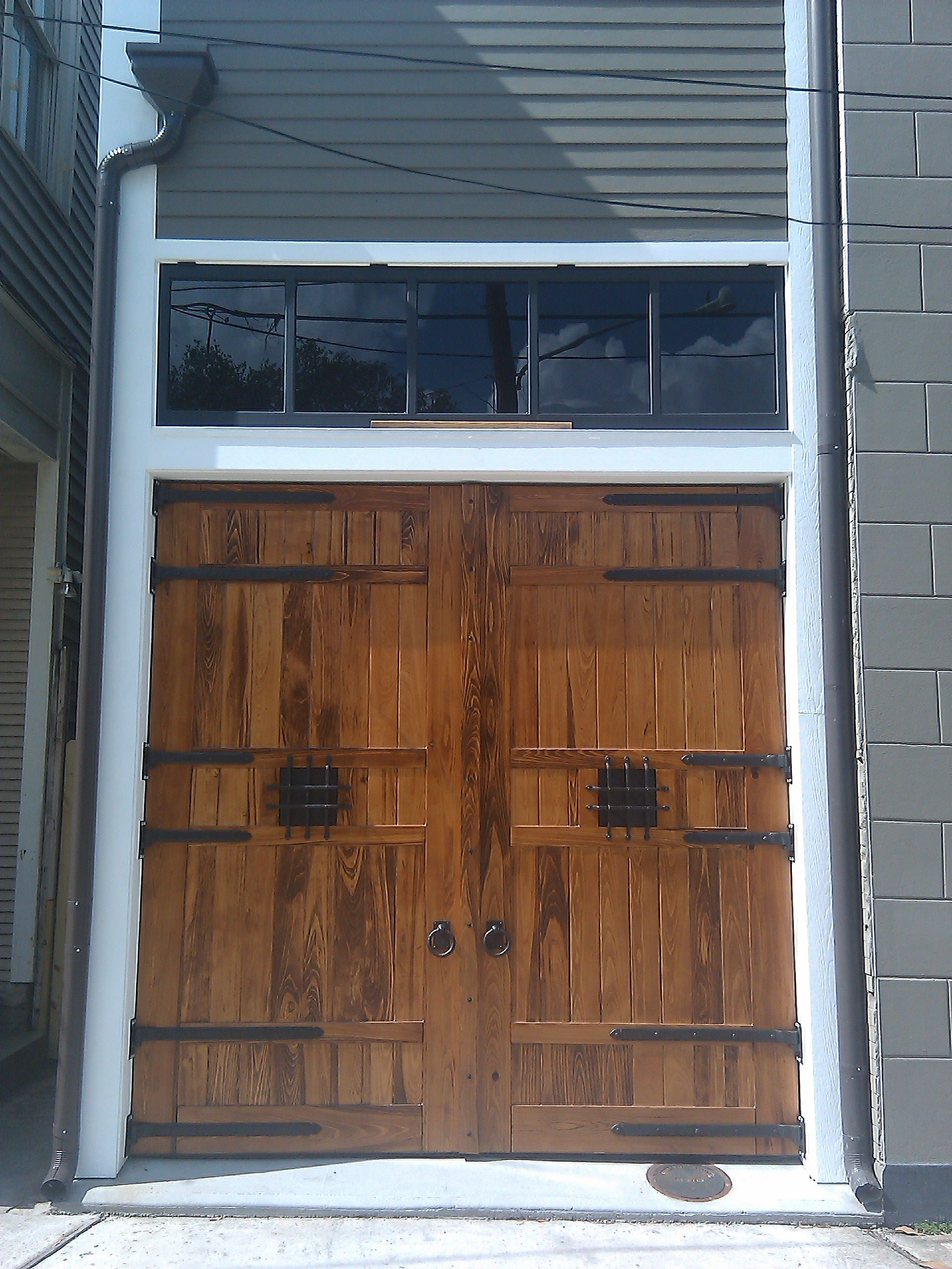 New Orleans historic carriage house doors with dark bronze