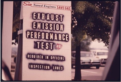 Close-up of a service station sign in downtown Cincinnati, Ohio advertising tune-ups to pass emission and safety tests
