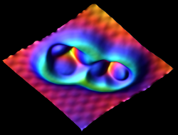 An AFM image of an iron trimer next to an iron dimer on Cu (111). Image provided by Franz Giessibl, University of Regensburg, Regensburg, Germany.
