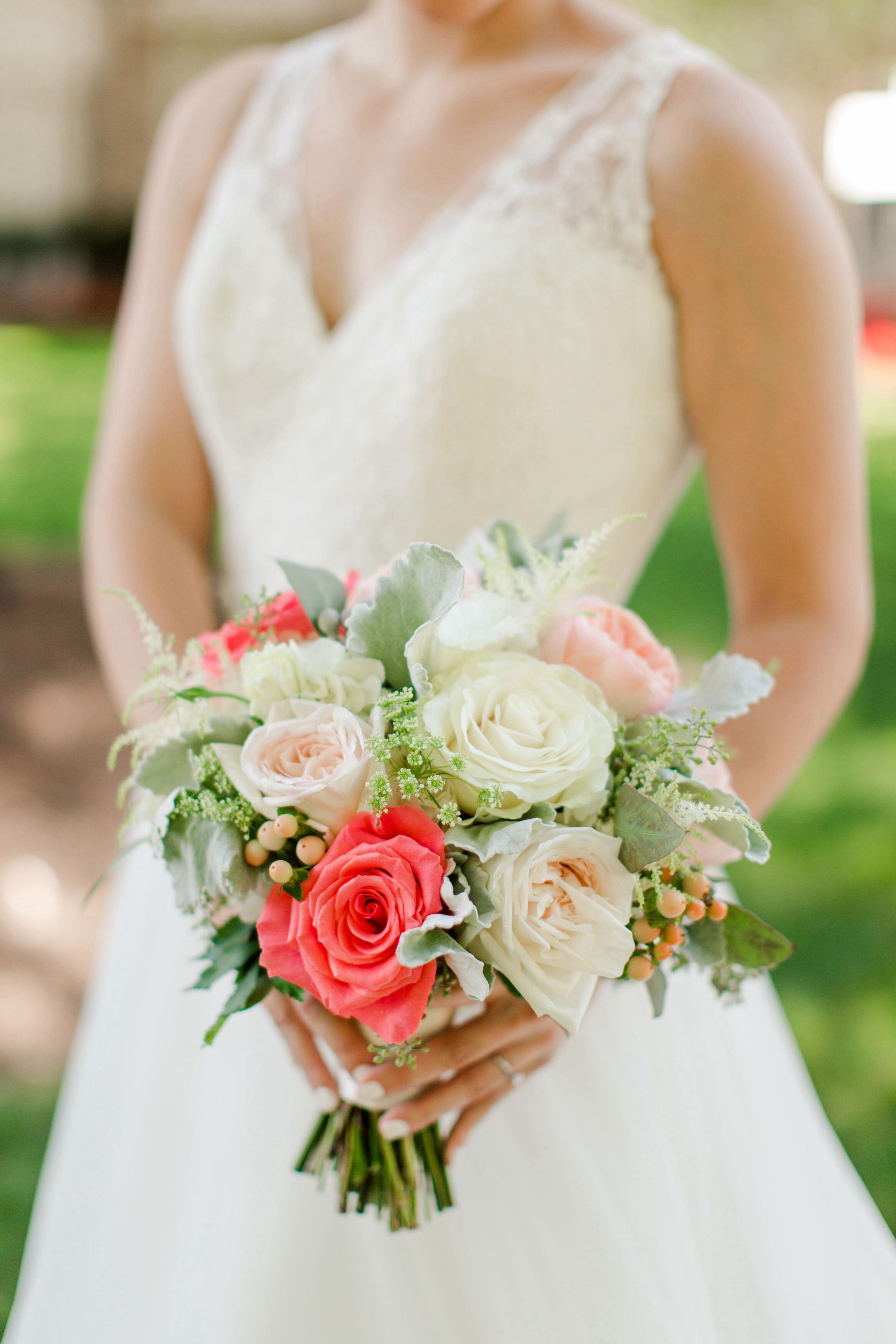 White Garden Rose Hair bridal bouquet with roses in coral, peach and white, peach berries
