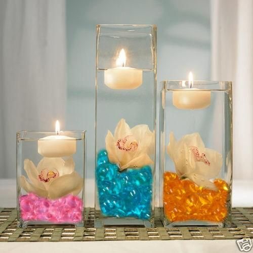 Flowers With Floating Candle Centerpieces: Blue Water Beads + Flower + Floating Candle = Prettiness
