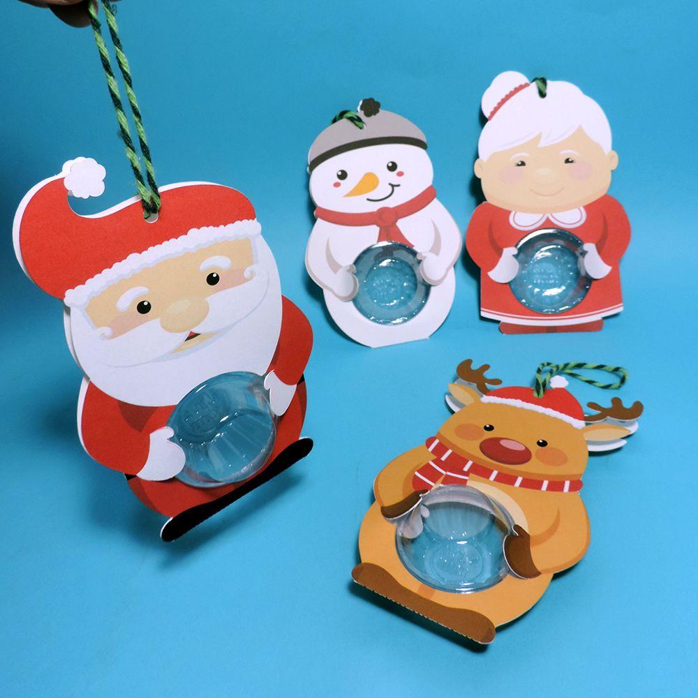 Cartão com blister para 1 doce ou brigadeiro com temática de Natal. São 4 modelos diferentes: papai Noel, mamãe Noel, rena Rudolph e boneco de neve.