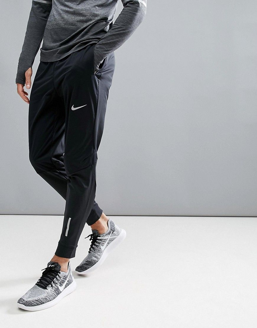 d99f83479ee9 Get this Nike Running s skinny trousers now! Click for more details.  Worldwide shipping. Nike Running Shield Phenom Trousers In Black 859234-010  - Black  ...
