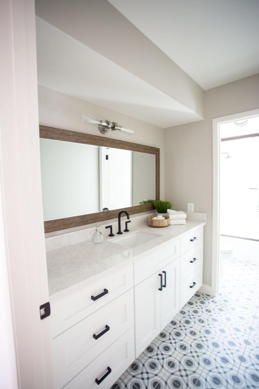 Simple, Stylish Bathroom Featuring Marble Vanity ...