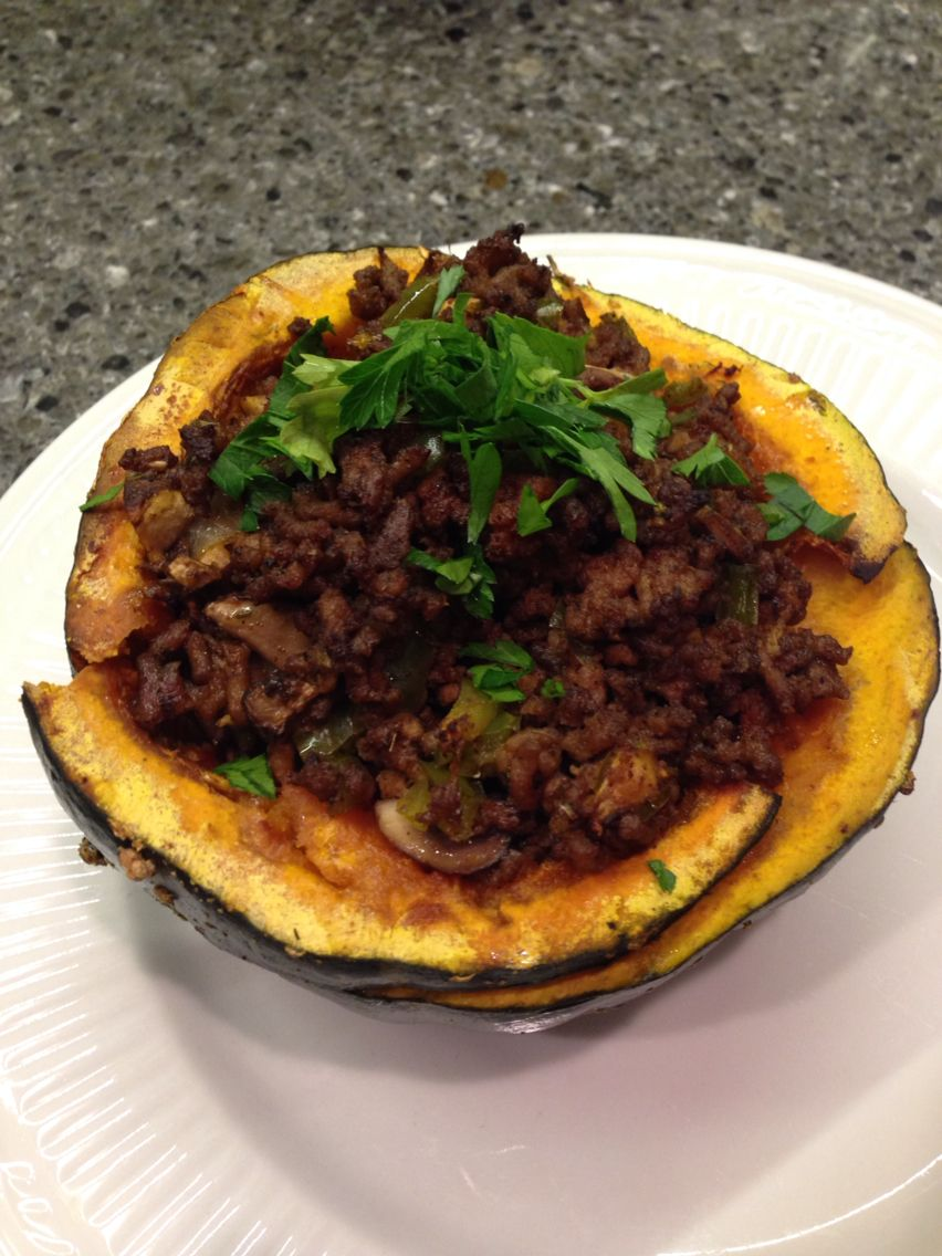 maple, red pepper flake grass fed ground beef stuffed squash garnished with fresh parsley