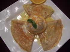 Crepes Suzette with Orange Sauce and Ice Cream. Classic Recipe.
