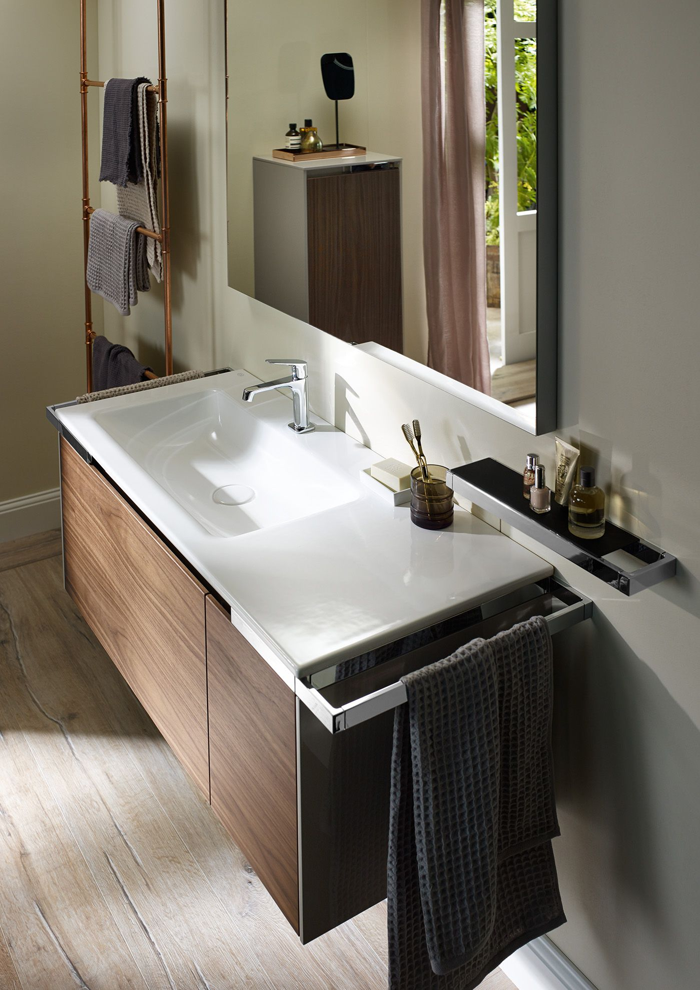 burgbad yso thanks to its asymmetric shape this ceramic top burgbad yso thanks to its asymmetric shape this ceramic top vanity unit is a truly miraculous space saver above it the perfect illustration of how the