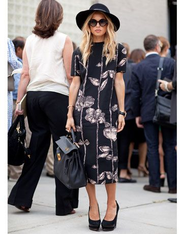 Rachel Zoe keeps up her boho image in a floppy hat, but pairs it with a refined floral dress.