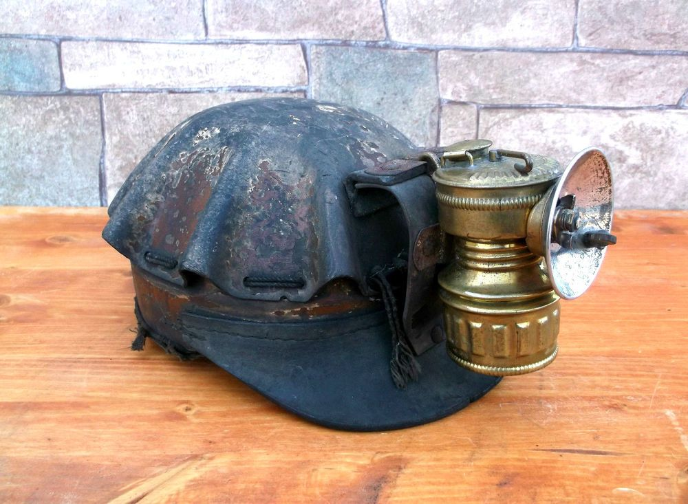 Antique turtle shell coal mining helmet carbide lantern