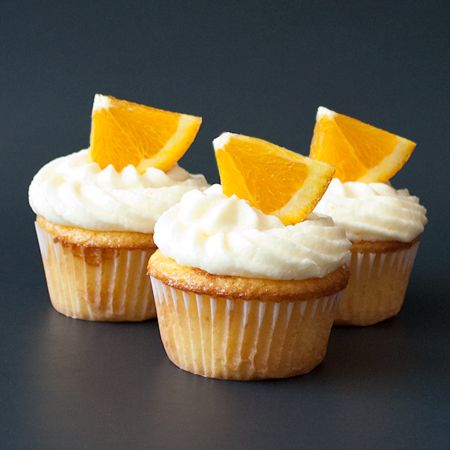 orange cupcakes (yellow cake mix) with orange buttercream frosting