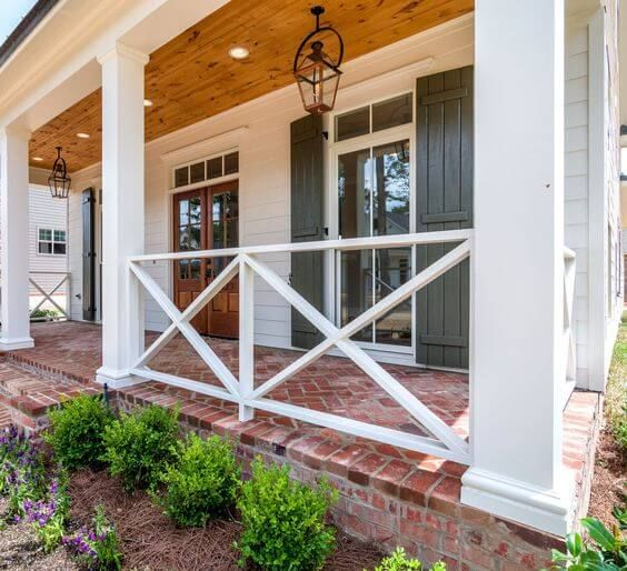 From Wood Deck Wrought Iron Lattice Panels And Steel Cable To Glass Panels Knee Walls And More We Have Plent House Exterior Porch Design House With Porch