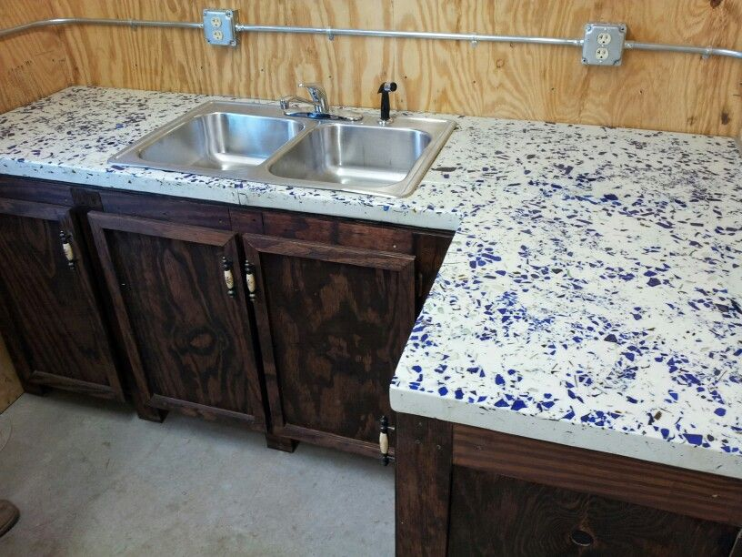 Recycled blue glass with white concrete countertop for dairy farm office
