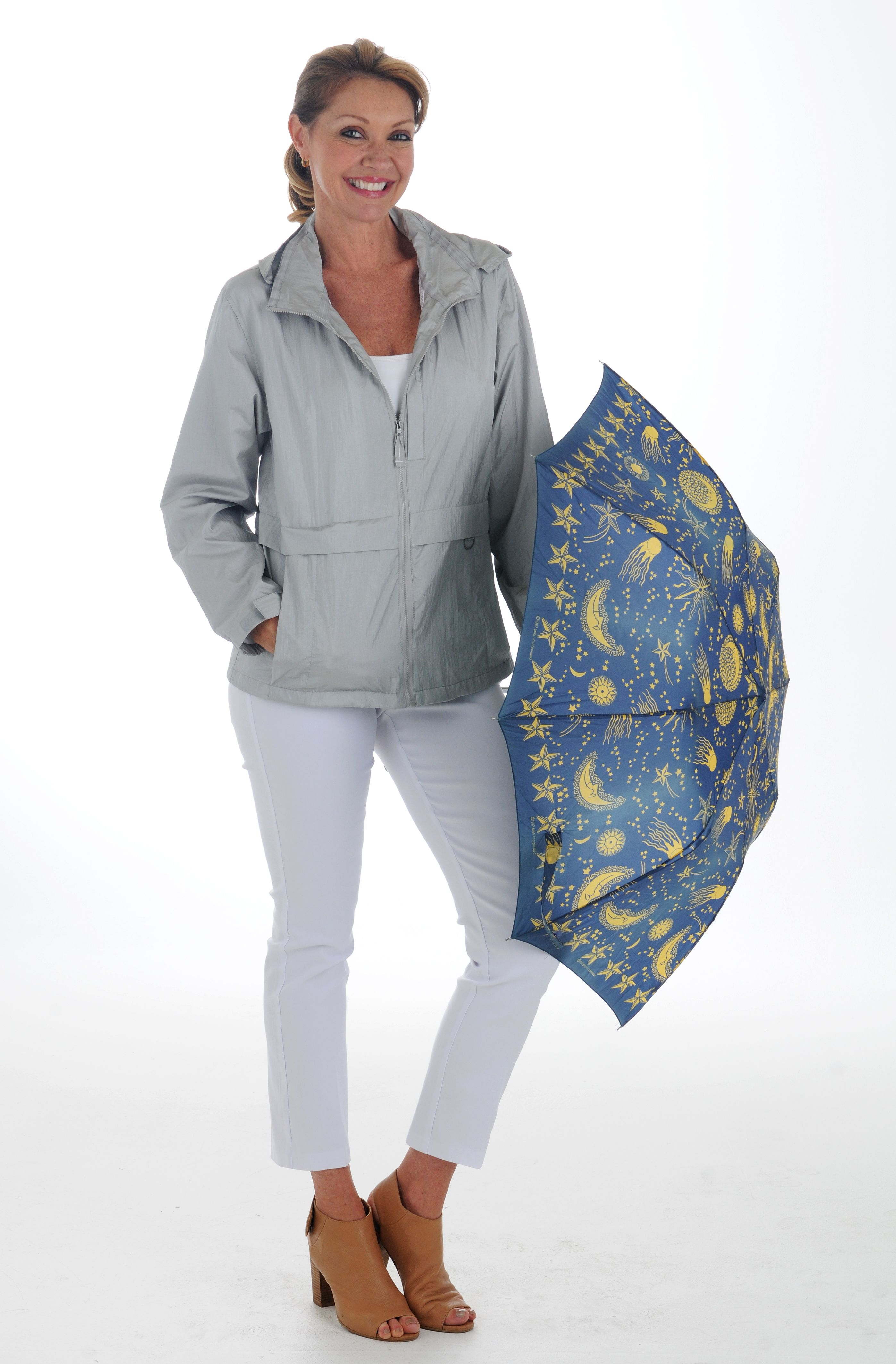 When summer comes in Florida, so do the afternoon showers. Don't be caught unprepared, grab this lightweight nylon jacket by Neyelle. Perfect for warm summer rain storms.