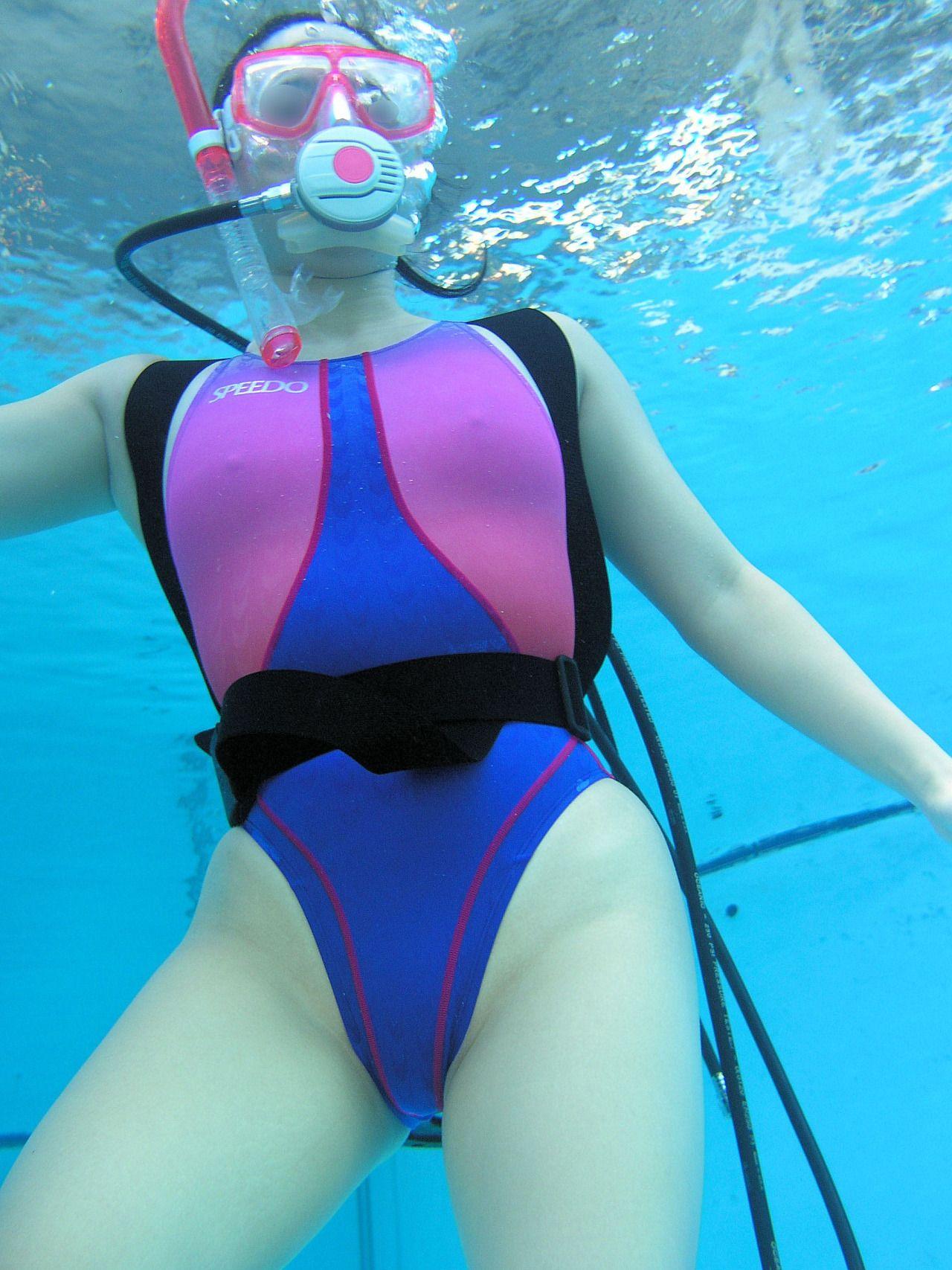 Underwater woman portrait with pink bikini in swimming pool stock image
