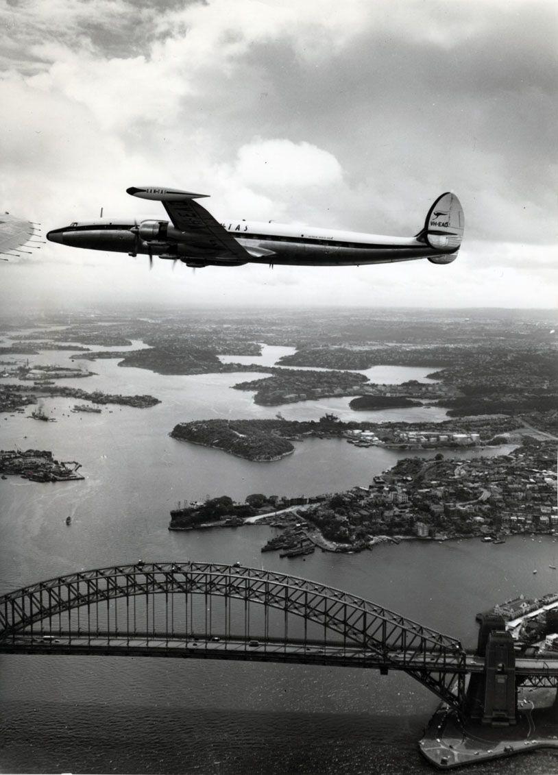 (L1049 in flight) Lockheed Super Constellation over