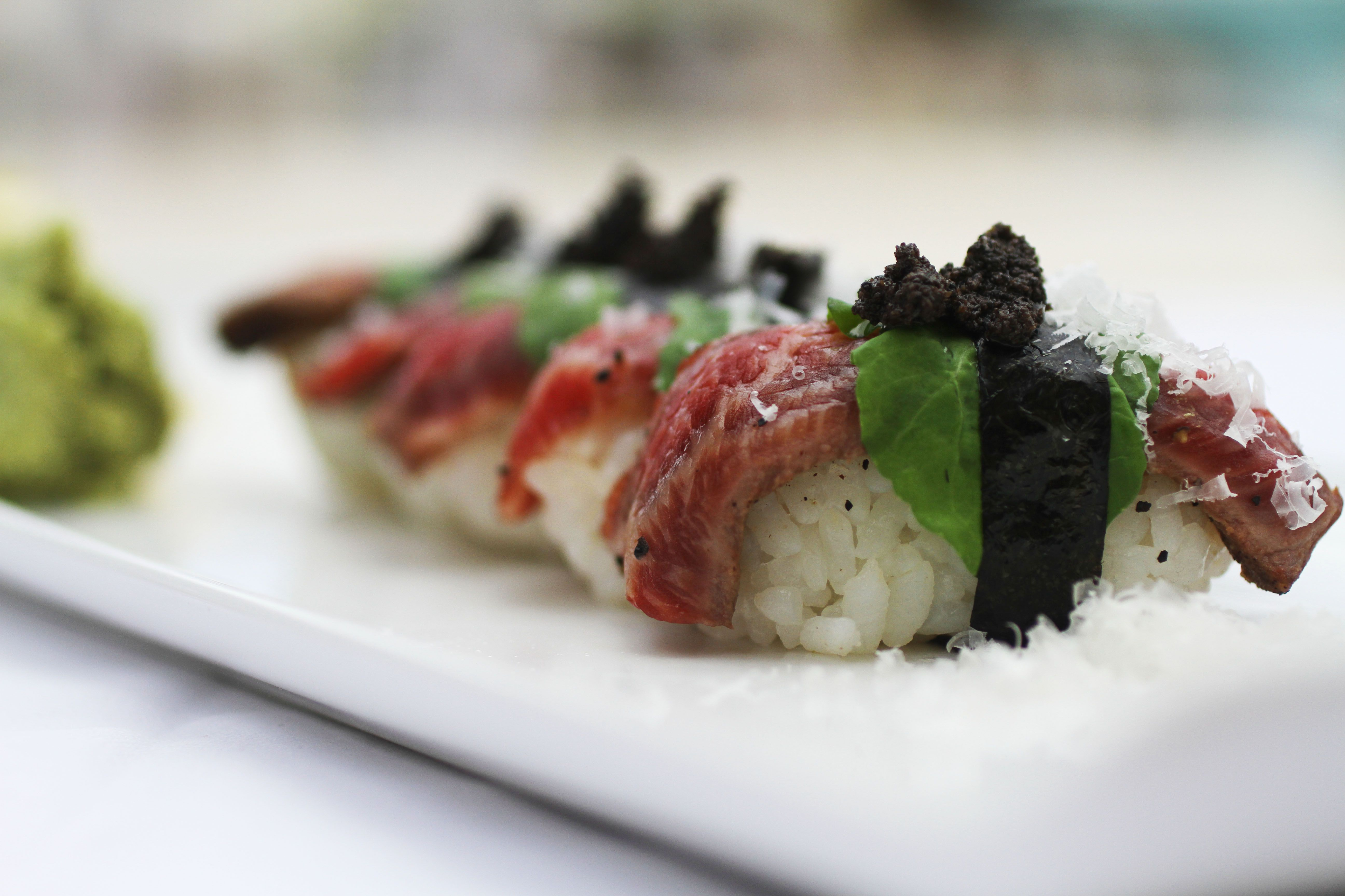 34f309bb666e  Sushi like you ve never had it before  Kobe beef nigiri wrapped with nori  and topped with truffle shavings.