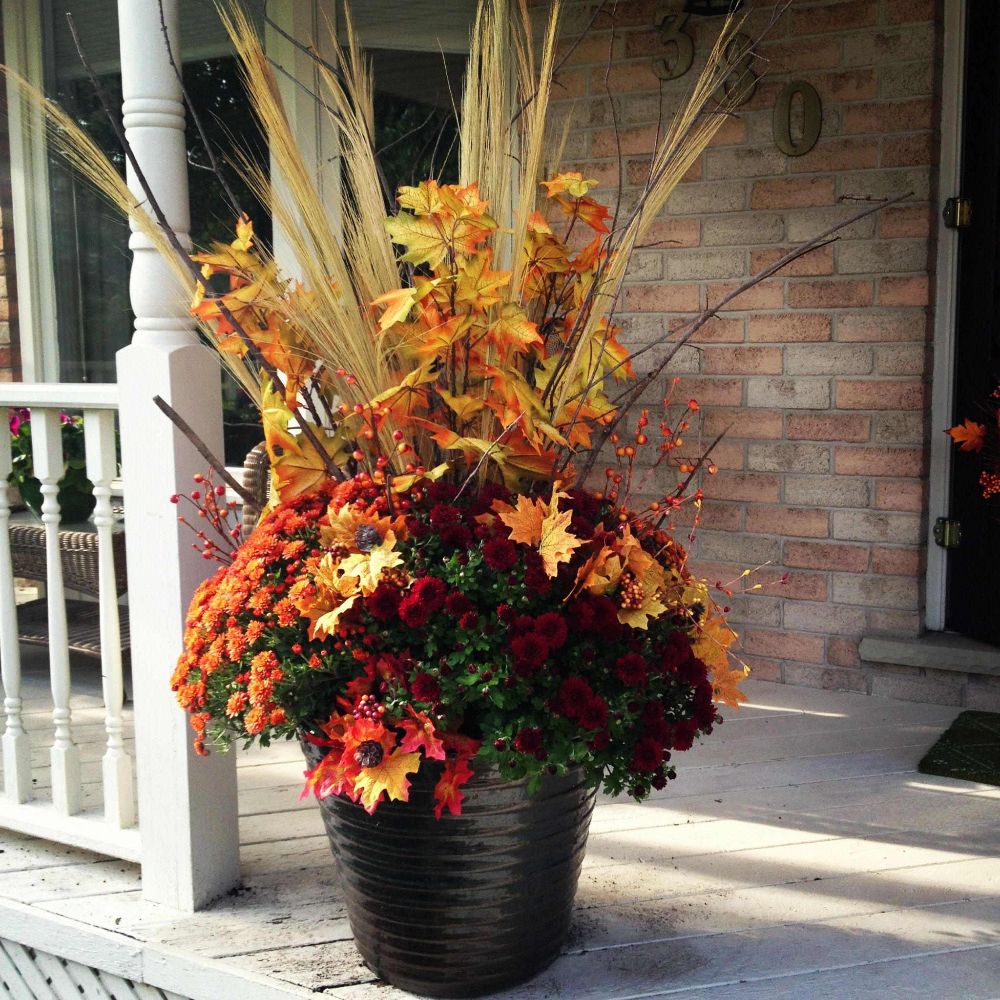 Fall planter for under $20! Dollar store fake leaves and backyard branches added to your supermarket mums. Makes one prefect seasonal planter. & Fall planter for under $20! Dollar store fake leaves and backyard ...
