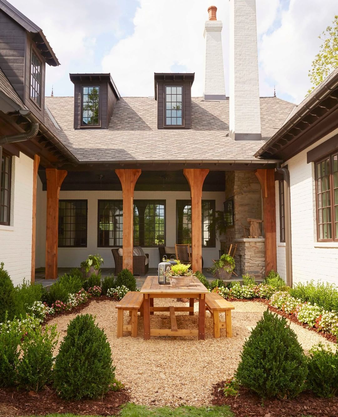 This french country cottage was designed in a u shape to create a private courtyard escape in the middle of the home we are ready to