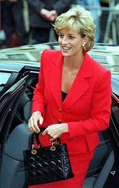 e46e3a505166 Princess Diana carrying her Lady Dior bag.