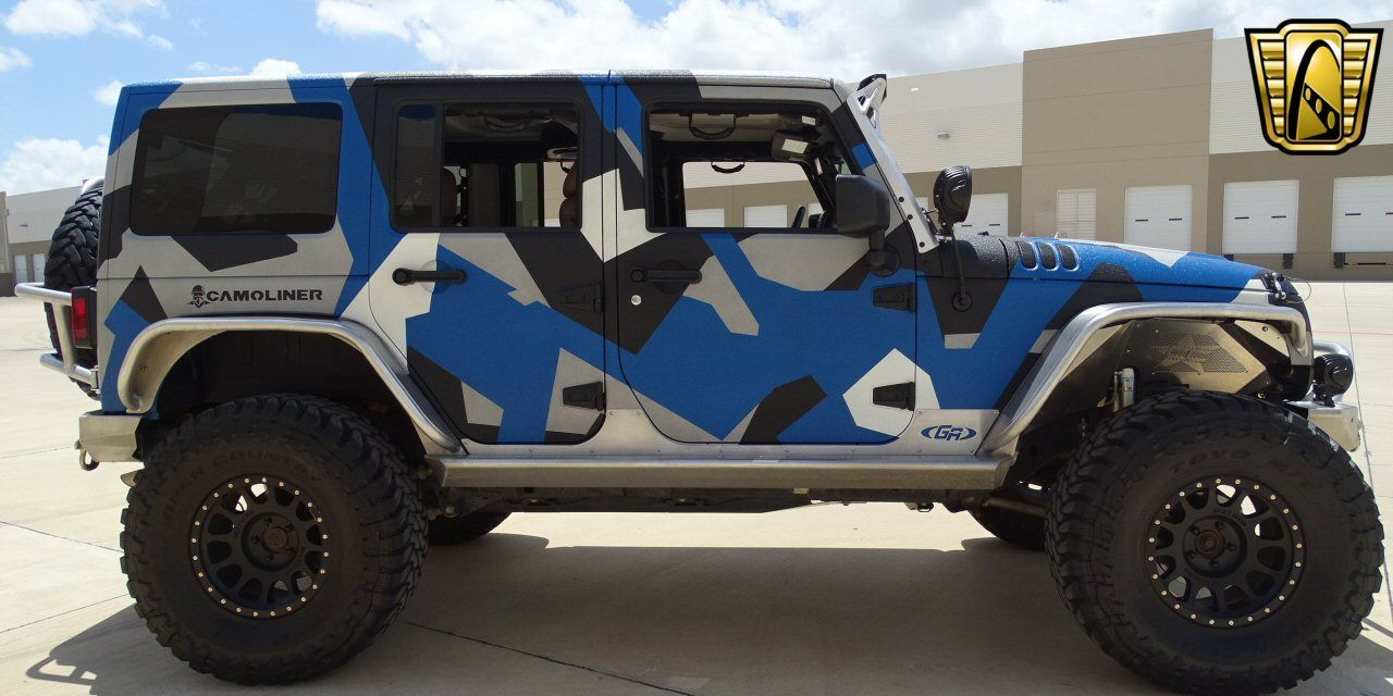 for sale in our dallas texas showroom is a black blue gray white sedan 2013 jeep wrangler. Black Bedroom Furniture Sets. Home Design Ideas