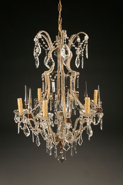Italian 6 arm iron and crystal antique chandelier with beads up the arms and 7 crystal spikes. Circa 1880. #antique #chandelier #iron #crystal