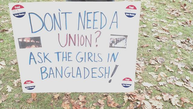 """A sign makes a point outside the Michigan Capitol as thousands march on Lansing, Mich., to protest anti-union legislation called """"Right to work."""" Photo by PW/John Rummel"""
