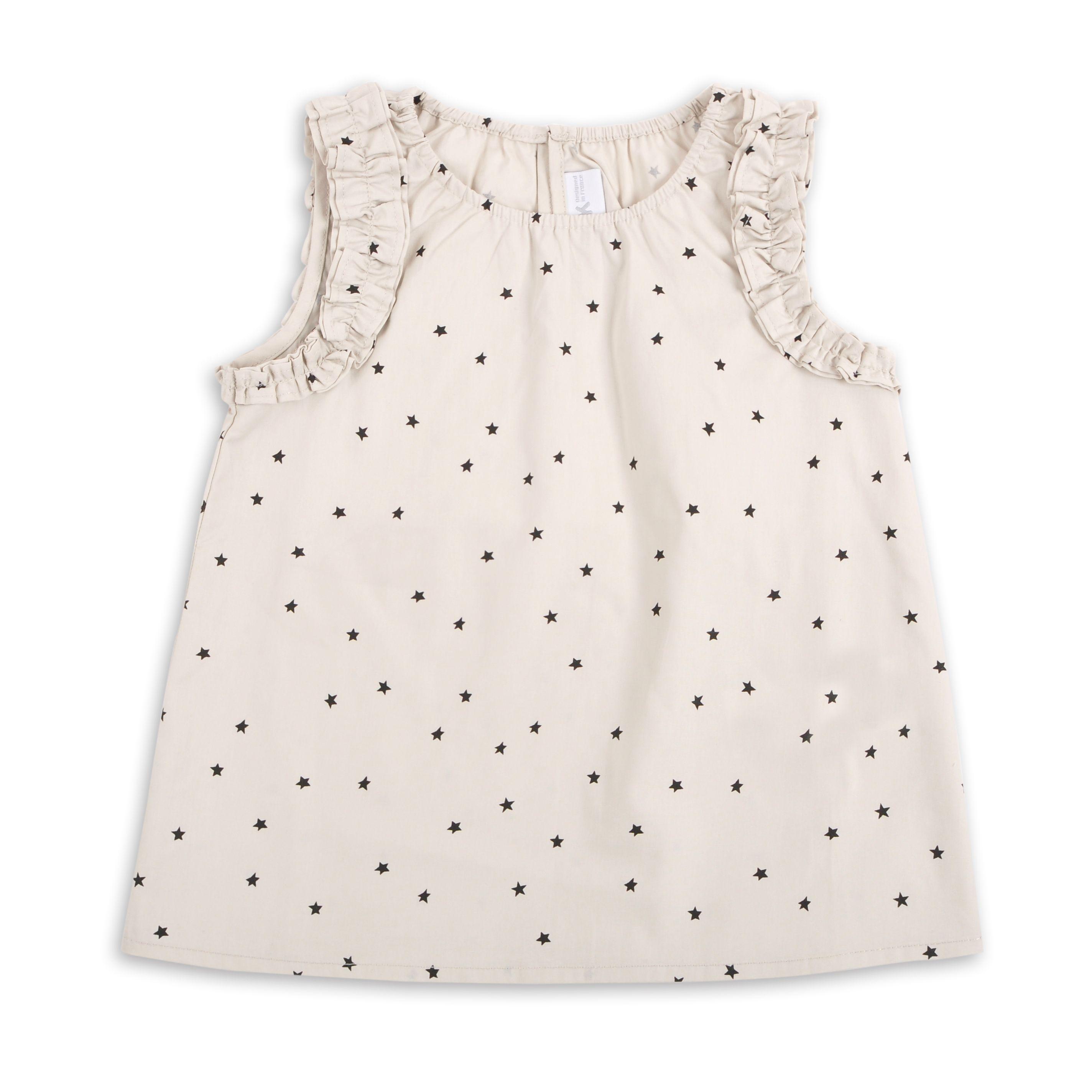 2502e8787 Blusa para niña, en color crema con estrellitas negras. EPK ...