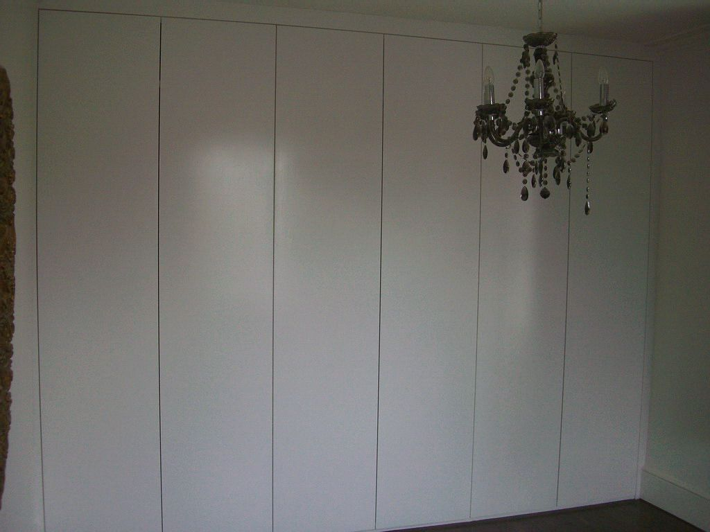 Fitted wardrobes bookcases shelving floating shelves London