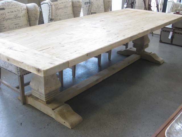 The rustic appeal of a reclaimed elm dining table is the basis for