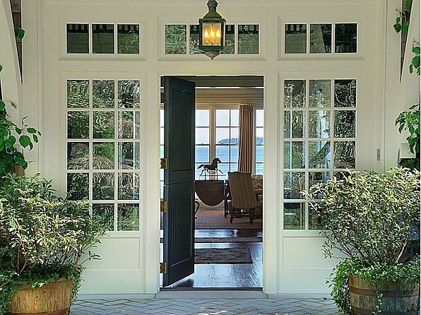 A hamptons style home on bainbridge island front doors for Outside door with window that opens