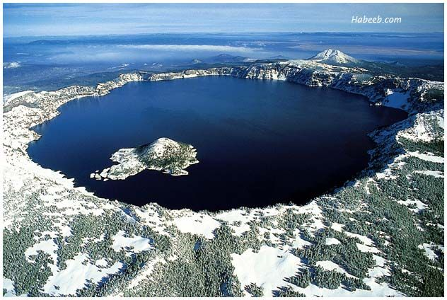 Crater Lake, Oregon.  Don't know if the Park is still open in winter with budget cuts, but you used to be able to stay at the lodge on the island in winter. Simply Beautiful.