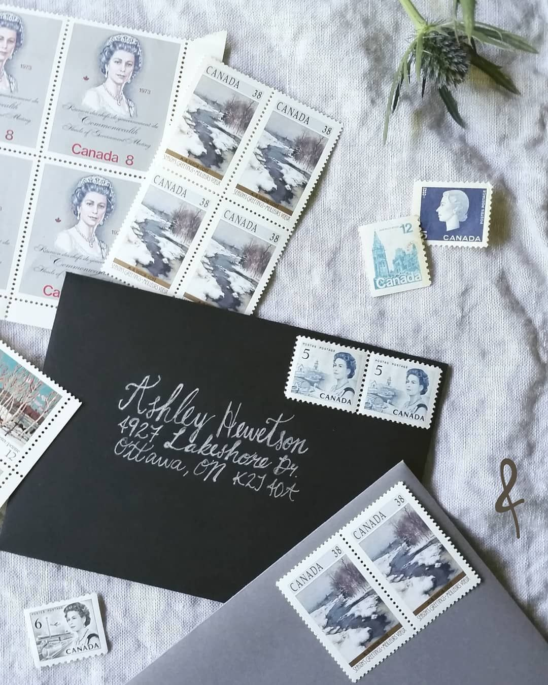A selection of Canadian vintage stamps in shades of grey
