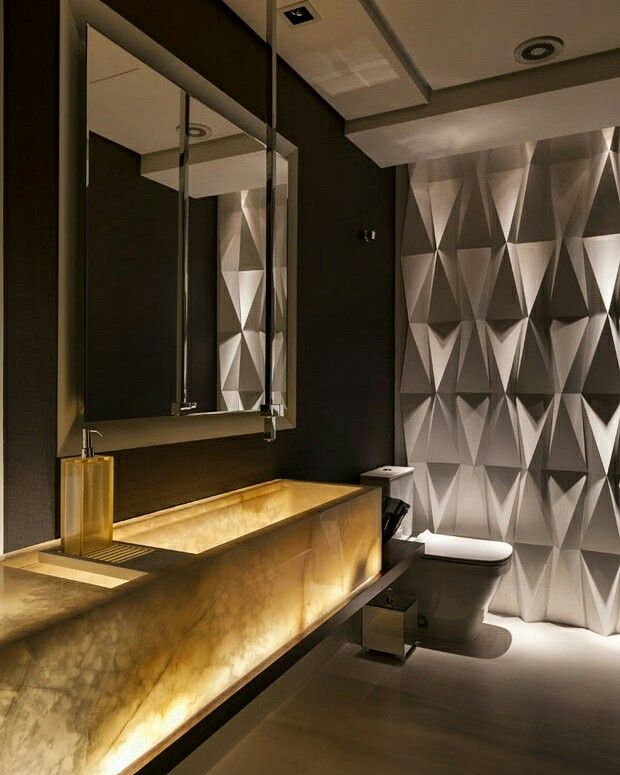 Geometria e iluminação destaca esse lindo banheiro