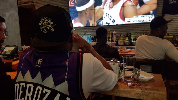 Raptors fans gather at the Charles Bar in Vancouver to support their team.