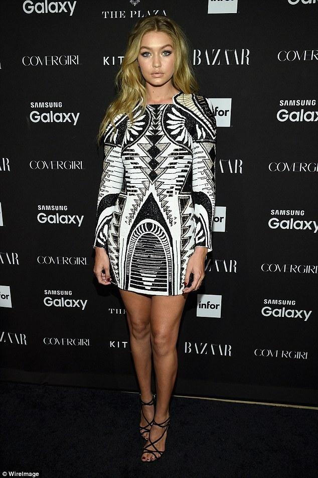 Gigi Hadid wearing H&M x Balmain Printed Dress and Dolce